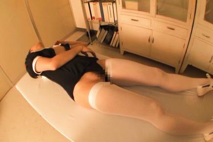 Kurumi tachibana. Wet Kurumi Tachibana is lying clothed and smiling in the cam